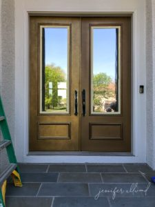 progress photo of gold front door with a faux finish